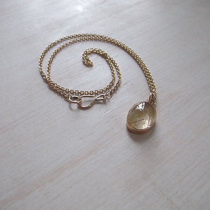 Rutillated quartz oval pendant on 14k cable chain