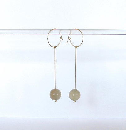 Long gold dangling earrings with moonstones
