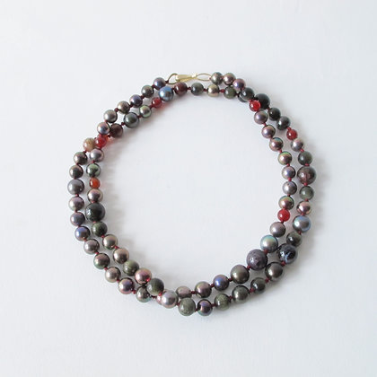 Black pearl and mixed gemstone long strand necklace