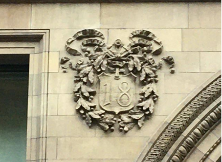 A wreath-like garland carved in stone