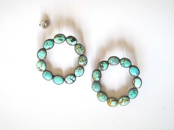 Turquoise with matrix circle hoops in blackened silver