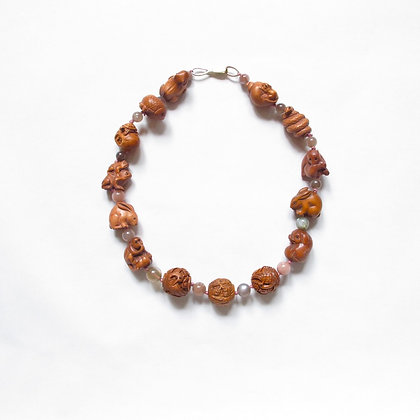 One of a kind Carved wood animal bead necklace
