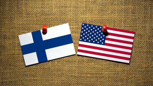 USA and Finland flag on sackcloth Backgr
