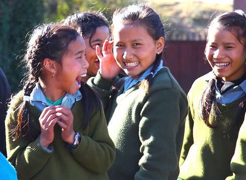 Nepali students joyfully smiling at the camera
