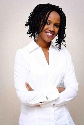 Smiling Rwanda woman with white background and white shirt