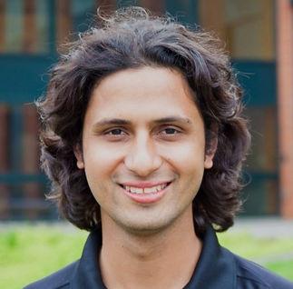 Smiling Nepali man with medium length hair
