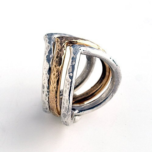 "Rings in sterling silver and bronze. ""Magical heart"""