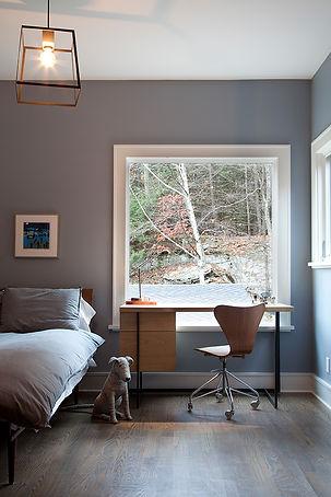 Blue gray bedroom, gray bedroom, dark wood floors, large bedroom window