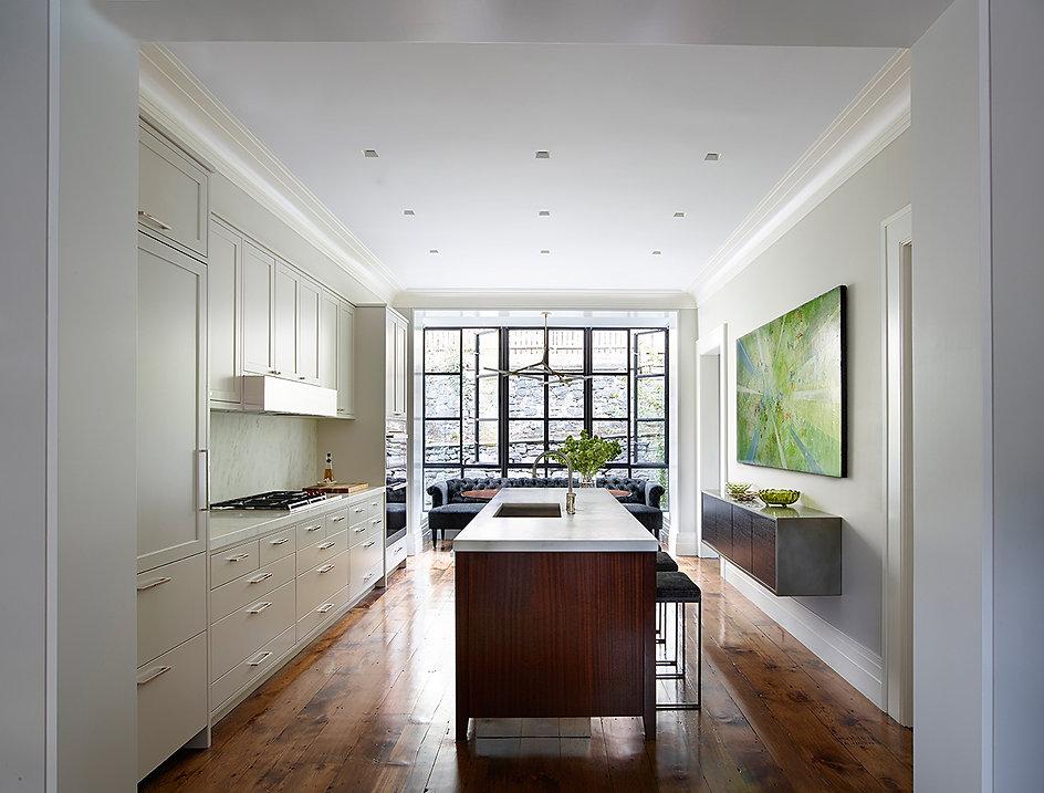 Large steel windows, wall-hung buffet
