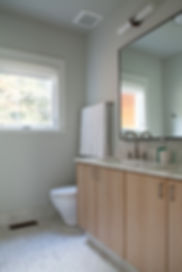 Atelier Delalain custom mirror, Imperial Danby countertop, Imperial Danby floors