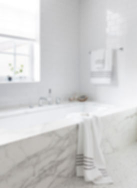 Brooklyn interior design, cozy calm home, feng shui New York City, Catherine Brophy interior design, transform your home, transform your space, Calacatta gold tub surround, clean modern bathroom, white modern bathroom