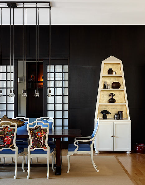 Gold leaf obelisk cabinet, Josef Frank fabric dining chair, Modern Tribeca loft