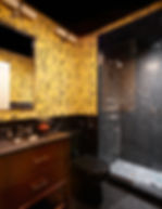 Hunt Slonem yellow bunnies wallpaper, Nero Marquina shower tiles