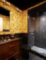 Hunt Slonem yellow bunnies wallpaper, Nero Marquina shower tiles