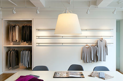 White lacquer display table, Modern NYC clothing showroom