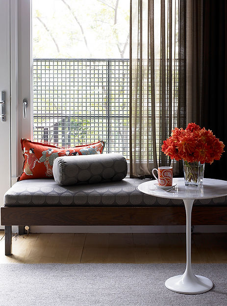 Saarinen side table, sheer drapery, modern window seat
