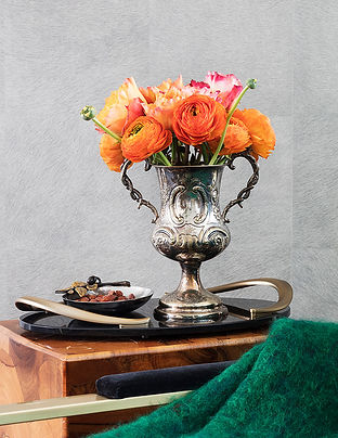 Coral Ranunculus, silver vase, lifestyle shot with flowers