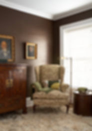 Dark brown waxed walls, library wing chair, Brooklyn brownstone, Traditional interior design