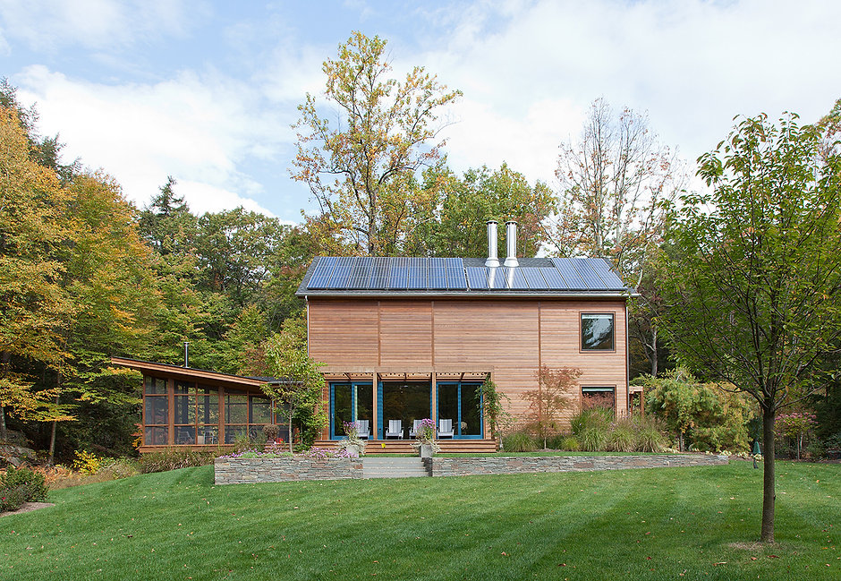 Woodstock country house, rustic retreat, modern house in upstate New York, screened-in porch, stone wall landscaping, solar panels