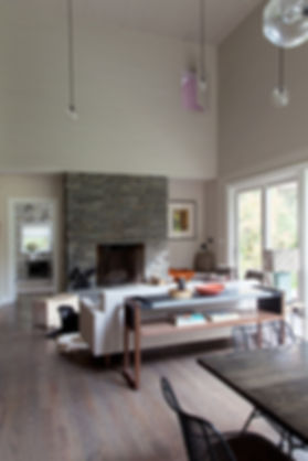 Lindsey Adelman custom pendants, field stone fireplace, wood clad walls, shiplap walls
