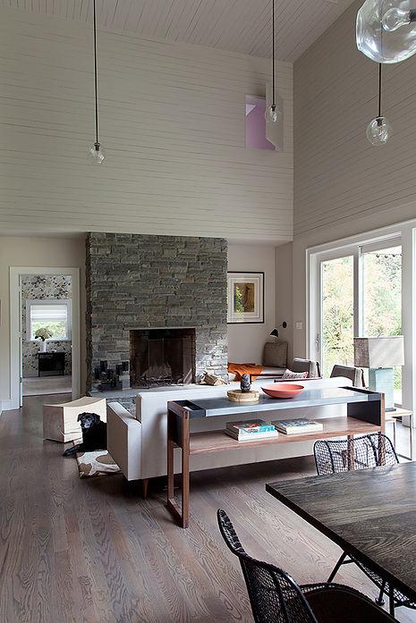 Lindsey Adelman custom pendants, field stone fireplace, wood clad walls, shiplap walls