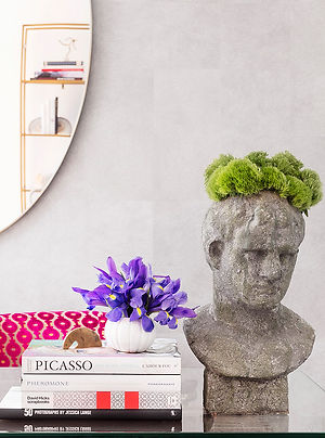 Stone head vase, pink patterned chair