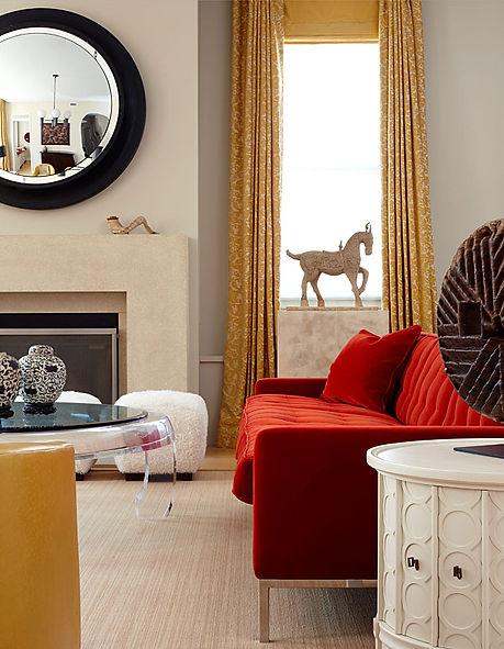 Large convex mirror, Knoll style red velvet sofa, Modern Tribeca loft