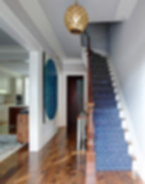 Gold Morroccan pendant, blue ivory wool stair runner, pine floors