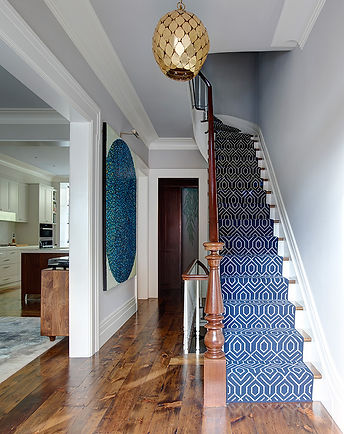 Gold Morroccan pendant, blue ivory wool stair runner, pine floors