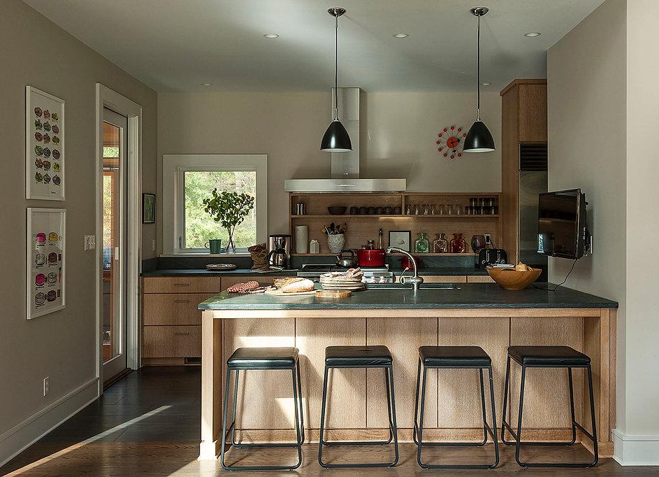 Bestlite pendants, Pietra Cardosa countertop, cerused oak cabinetry, country kitchen