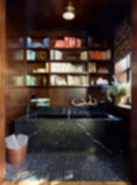 Built in mahogany shelving, Nero Marquina bathtub