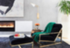 Milo Baughman style lounge chair, Kelly Wearstler sconce, modern gas fireplace, cozy reading chair