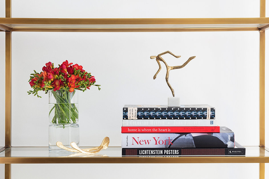 coral flowers, red flowers, stack of design books, gold wishbone, custom lifestyle