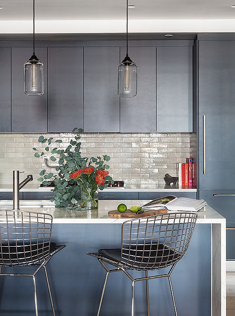Brooklyn interior design, cozy calm home, feng shui New York City, Catherine Brophy interior design, transform your home, transform your space, Calacatta marble island, niche modern pendants, dark modern kitchen cabinetry, glazed brick backsplash, Bertoia barstools, open kitchen