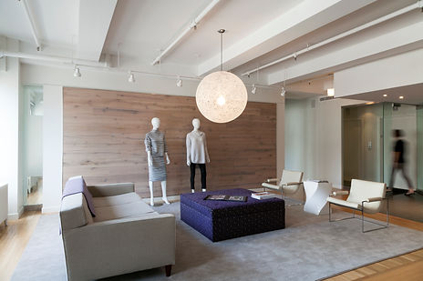 DWR random pendant, purple velvet ottoman, Modern NYC clothing showroom