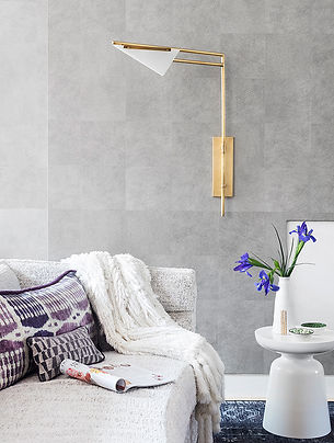 Elitis gray vinyl faux hair-on-hide wallpaper, Kelly Wearstler sconce, curved white sofa