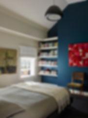 Dark blue wall, dark bedroom
