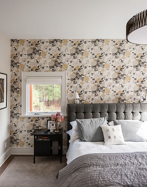Floral wallpaper, tufted gray headboard