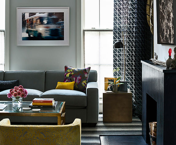 Graphic drapery, black marble with leather finish fireplace, A. Rudin sofa