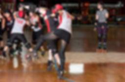 roller girl playing roller derby on roller skates