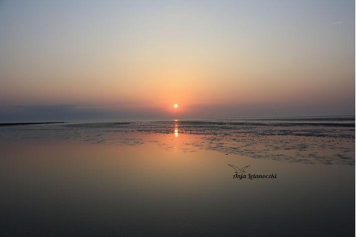 Sonnenuntergang_Watt_Signatur.jpg