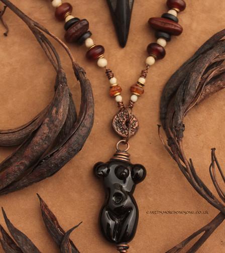 black imperfect goddess crow skull.jpg