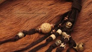 Tibetan brass skull beads, bone, bells and mole vertebrae.