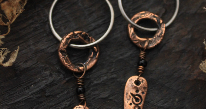 small cup and ring marking earrings clos