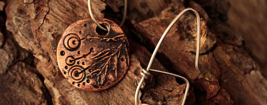 nature energetics disk earrings.jpg