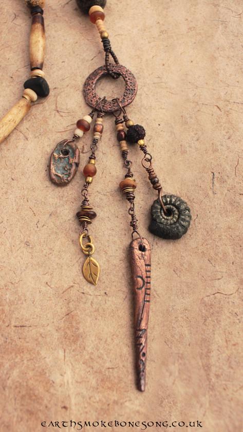 Calendar stick, pyrite fossil, bronze trinket.