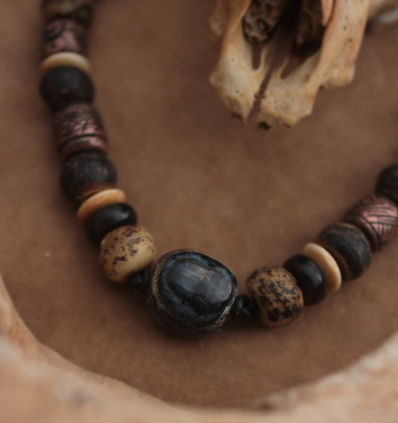 mammoth tooth necklace with bones.jpg