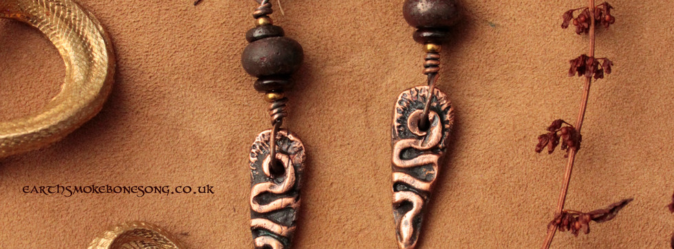 trickster snake earrings red clay beads.