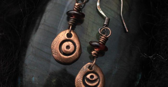 garnet moon and sun earrings close.jpg