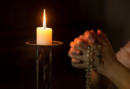 person holding white pillar candle_edited.jpg